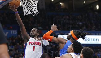 Detroit Pistons guard Reggie Jackson (1) shoots in front of Oklahoma City Thunder center Nerlens Noel, right, during the first half of an NBA basketball game Friday, Feb. 7, 2020, in Oklahoma City. (AP Photo/Sue Ogrocki)