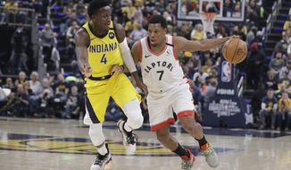 Toronto Raptors' Kyle Lowry (7) is defended by Indiana Pacers' Victor Oladipo (4) during the first half of an NBA basketball game, Friday, Feb. 7, 2020, in Indianapolis. (AP Photo/Darron Cummings)