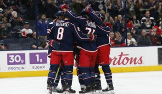 Columbus Blue Jackets celebrate a goal against the Detroit Red Wings during the second period of an NHL hockey game Friday, Feb. 7, 2020, in Columbus, Ohio. (AP Photo/Jay LaPrete)