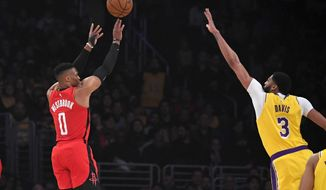 Houston Rockets guard Russell Westbrook, left, shoots as Los Angeles Lakers forward Anthony Davis defends during the first half of an NBA basketball game Thursday, Feb. 6, 2020, in Los Angeles. (AP Photo/Mark J. Terrill)