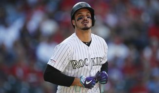 FILE - In this Sept. 12, 2019, file photo, Colorado Rockies' Nolan Arenado reacts after being put out against the St. Louis Cardinals in the eighth inning of a baseball game in Denver. Arenado, the Rockies' top player, is at odds with the team's management as spring training opens for the club. (AP Photo/David Zalubowski, File)