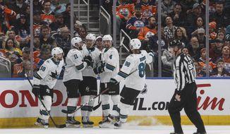 San Jose Sharks celebrate a goal against the Edmonton Oilers during the second period of an NHL hockey game Thursday, Feb. 6, 2020, in Edmonton, Alberta. (Jason Franson/The Canadian Press via AP)