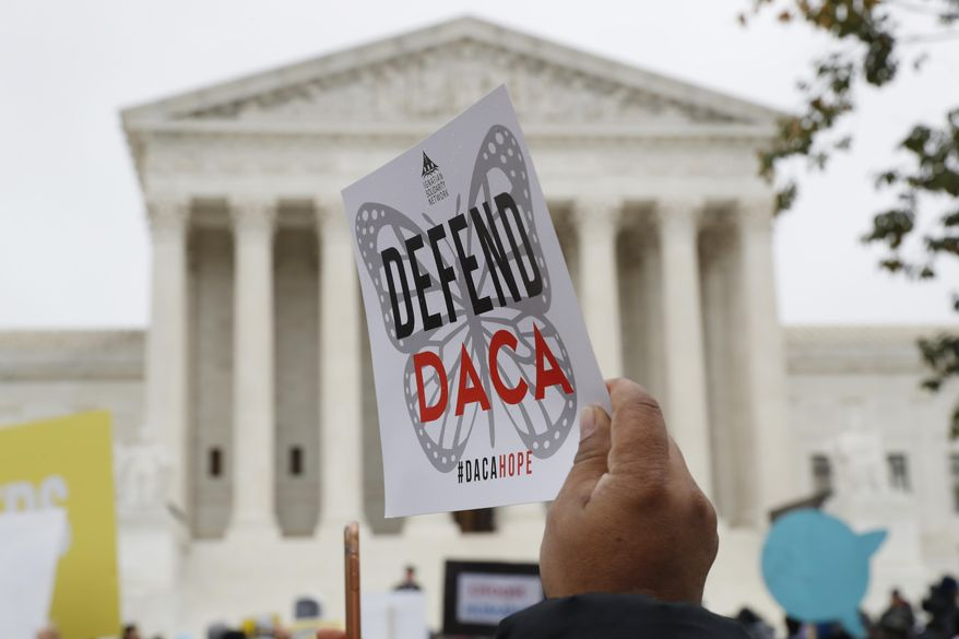 In this Nov. 12, 2019, file photo people rally outside the Supreme Court as oral arguments are heard in the case of President Trump's decision to end the Obama-era, Deferred Action for Childhood Arrivals program (DACA), at the Supreme Court in Washington.  (AP Photo/Jacquelyn Martin, File)  **FILE**