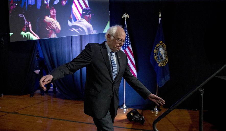 """Democratic presidential candidate Sen. Bernie Sanders, I-Vt., arrives to speak at """"Our Rights, Our Courts"""" forum New Hampshire Technical Institute's Concord Community College, Saturday, Feb. 8, 2020, in Concord, N.H. (AP Photo/Andrew Harnik)"""