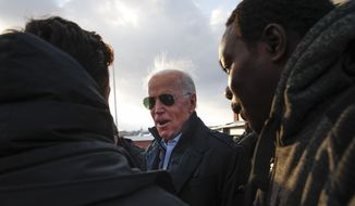 Democratic presidential candidate former Vice President Joe Biden speaks with a supporters outside the Biden for President Manchester Field Office, Saturday, Feb. 8, 2020 in Manchester, N.H. (AP Photo/Pablo Martinez Monsivais)