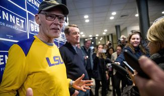 James Carville, a political commentator known for leading former President Bill Clinton's 1992 presidential campaign, left, accompanied by Democratic presidential candidate Sen. Michael Bennet, D-Colo., center, speaks to members of the media before a campaign stop at the Spotlight Room at the Palace, Saturday, Feb. 8, 2020, in Manchester, N.H. (AP Photo/Andrew Harnik)