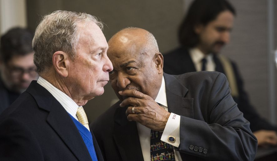 Democratic presidential candidate Mike Bloomberg talks with Alabama Democratic Conference chair Joe Reed during the ADC Luncheon at Embassy Suites in Montgomery, Ala., on Saturday, Feb. 8, 2020. (Montgomery Advertiser via AP)