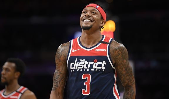 Washington Wizards guard Bradley Beal (3) reacts on the court during the first half of an NBA basketball game against the Dallas Mavericks, Friday, Feb. 7, 2020, in Washington. (AP Photo/Nick Wass) ** FILE **
