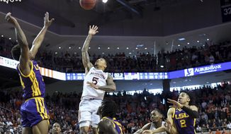 Auburn guard J'Von McCormick (5) shoots the game-winning basket in overtime over an LSU defender during an NCAA college basketball game Saturday, Feb. 8, 2020, in Auburn, Ala. auburn won 91-90 in overtime.(AP Photo/Julie Bennett)