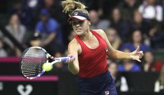 United States' Sofia Kenin hits a forehand to Latvia's Anastasija Sevastova during a Fed Cup qualifying tennis match Friday, Feb. 7, 2020, in Everett, Wash. (AP Photo/Elaine Thompson)