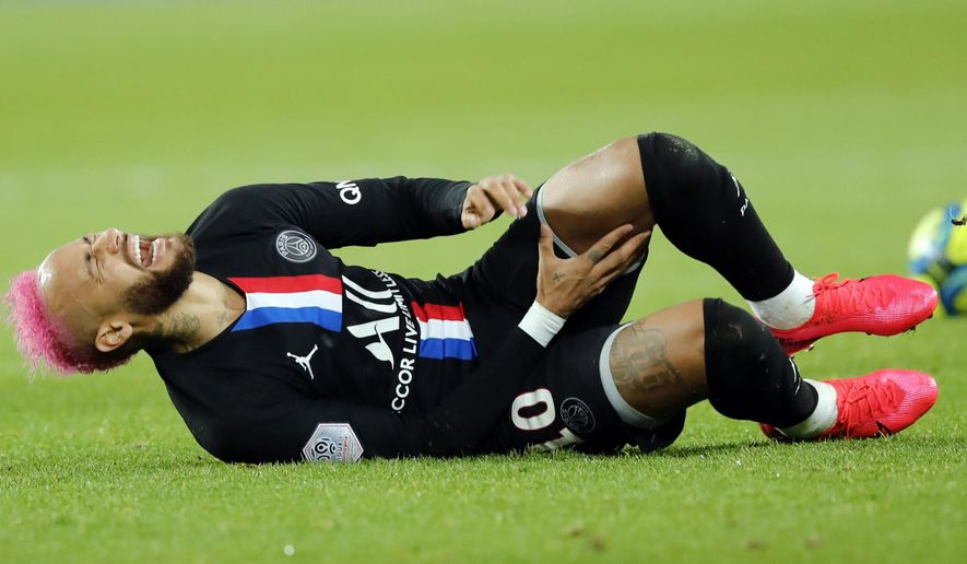 PSG's Neymar lies on the ground during the French League One soccer match between Paris-Saint-Germain and Montpellier at the Parc des Princes stadium in Paris, Saturday Feb. 1, 2020. (AP Photo/Christophe Ena)