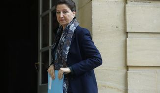 France's Health Minister Agnes Buzyn arrives to a meeting, at the hôtel Matignon, Paris, Saturday, Feb. 8, 2020. The announcement Saturday Agnes Buzyn brings the total number of people with the virus in France to 11. Buzyn said they appear linked to a British person who stayed there in late January, and was later to confirmed to have the virus after returning to Britain. (AP Photo/Thibault Camus)