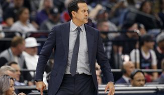 Miami Heat coach Erik Spoelstra glares at the referees after a foul call against the Heat during the first quarter of the team's NBA basketball game against the Sacramento Kings in Sacramento, Calif., Friday, Feb. 7, 2020. 6(AP Photo/Rich Pedroncelli)