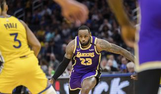 Los Angeles Lakers forward LeBron James (23) dribbles against the Golden State Warriors in the first half of an NBA basketball game in San Francisco Saturday, Feb. 8, 2020. (AP Photo/John Hefti)
