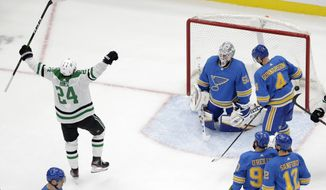 Dallas Stars' Roope Hintz (24), of Finland, celebrates after scoring past St. Louis Blues goaltender Jordan Binnington (50) and Carl Gunnarsson (4) during the second period of an NHL hockey game Saturday, Feb. 8, 2020, in St. Louis. Hintz also scored the game-winning goal in overtime. (AP Photo/Jeff Roberson)