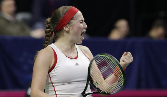 Latvia's Jelena Ostapenko reacts to winning a game against United States' Sofia Kenin in their third set during a Fed Cup qualifying tennis match Saturday, Feb. 8, 2020, in Everett, Wash. (AP Photo/Elaine Thompson)