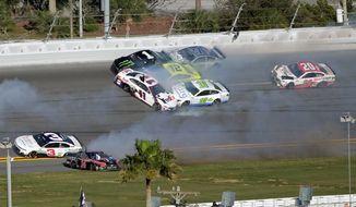 Erik Jones won Sunday's NASCAR Daytona Clash, which included Kurt Busch (1), Denny Hamlin (11), Aric Almirola (10), Ryan Blaney (12) and Kevin Harvick (4) involved in a multicar collision between Turns 3 and 4 at Daytona International Speedway. (ASSOCIATED PRESS)