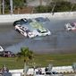 Erik Jones won Sunday's NASCAR Daytona Clash, which included Kurt Busch (1), Denny Hamlin (11), Aric Almirola (10), Ryan Blaney (12) and Kevin Harvick (4) involved in a multicar collision between Turns 3 and 4 at Daytona International Speedway. (ASSOCIATED PRESS)