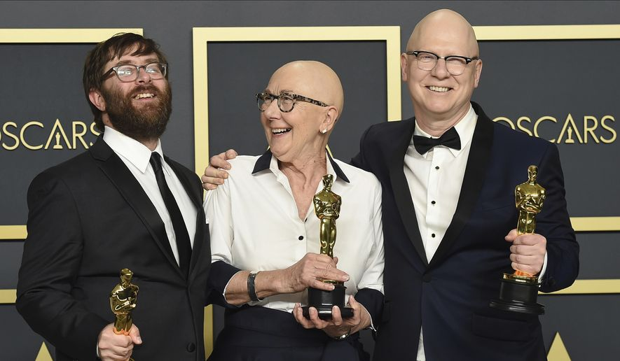 "Jeff Reichert, from left, Julia Reichert, and Steven Bognar, winners of the award for best documentary feature for ""American Factory"", pose in the press room at the Oscars on Sunday, Feb. 9, 2020, at the Dolby Theatre in Los Angeles. (Photo by Jordan Strauss/Invision/AP)"