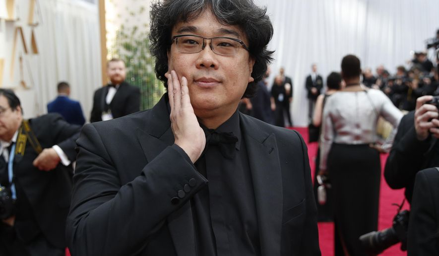 Bong Joon-ho arrives at the Oscars on Sunday, Feb. 9, 2020, at the Dolby Theatre in Los Angeles. (AP Photo/John Locher)