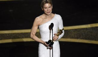 """Renee Zellweger accepts the award for best performance by an actress in a leading role for """"Judy"""" at the Oscars on Sunday, Feb. 9, 2020, at the Dolby Theatre in Los Angeles. (AP Photo/Chris Pizzello)"""