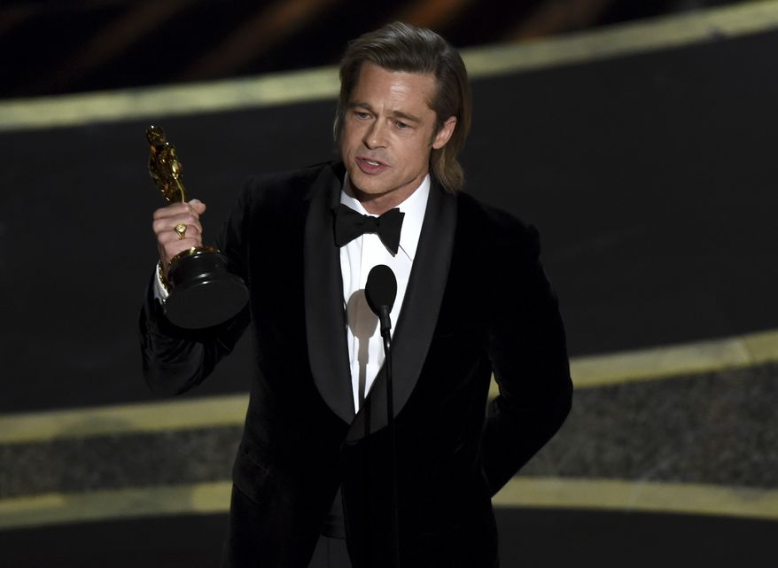 """Brad Pitt accepts the award for best performance by an actor in a supporting role for """"Once Upon a Time in Hollywood"""" at the Oscars on Sunday, Feb. 9, 2020, at the Dolby Theatre in Los Angeles. (AP Photo/Chris Pizzello)"""