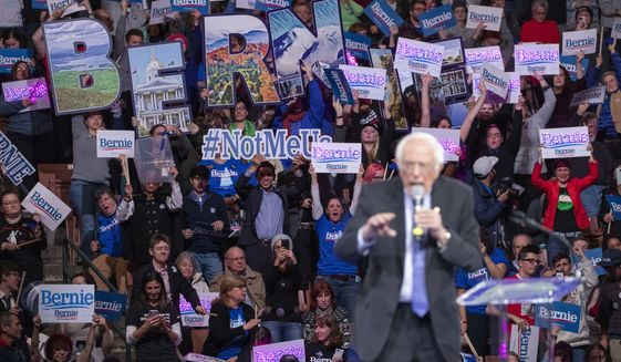 Supporters of Democratic presidential candidate Sen. Bernie Sanders, I-Vt., cheer as he speaks during the McIntyre-Shaheen 100 Club Dinner, Saturday, Feb. 8, 2020, in Manchester, N.H. (AP Photo/Mary Altaffer)