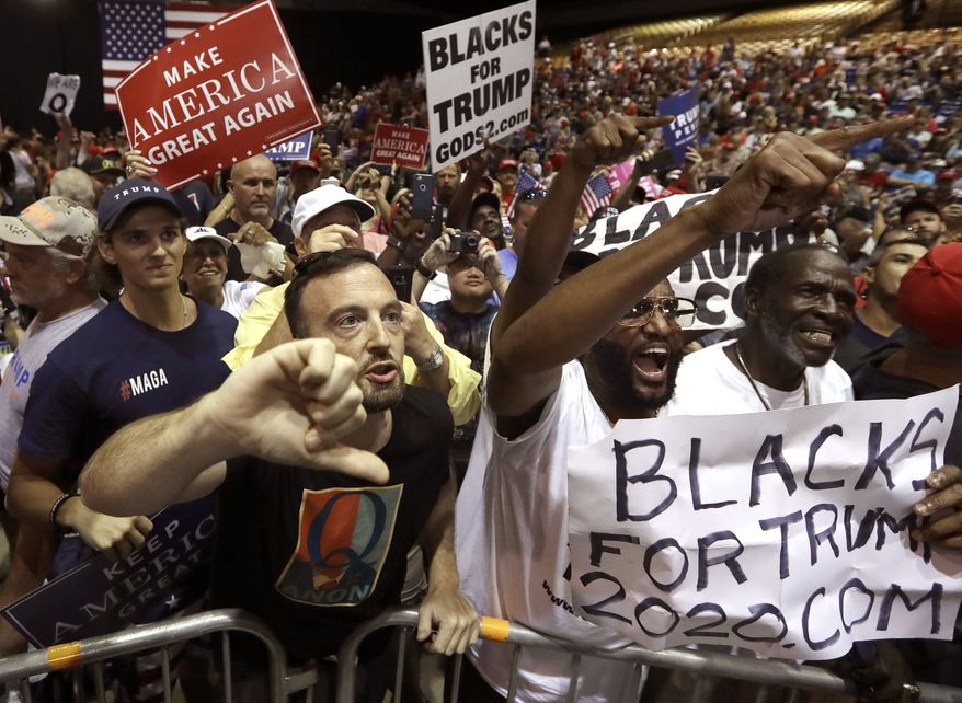 """In this July 31, 2018, file photo, supporters of President Donald Trump shout down a CNN news crew before a rally in Tampa, Fla. A far-right conspiracy theory forged in a dark corner of the internet is creeping into the mainstream political arena. It's called QAnon, and it centers on the baseless belief that President Donald Trump is waging a secret campaign against enemies in the """"deep state.""""  (AP Photo/Chris O'Meara, File)"""