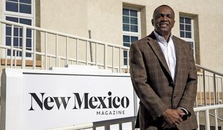 """In this Tuesday, Jan. 28, 2020, photo, Edward Graves, the new CEO/publisher of New Mexico Magazine, poses for a portrait outside the magazine's office in the Lew Wallace building in Santa Fe, N.M. Graves was chosen from a field of 12 qualified applicants, according to the New Mexico Tourism Department, under which the magazine falls. New Mexico Magazine is an """"enterprise fund"""" entity with a $3.2 million budget that is not funded by taxpayer dollars. (Luke E. Montavon/Santa Fe New Mexican via AP)"""