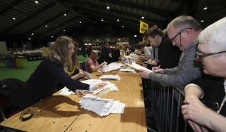 Counting starts for the Irish General Election in Dublin, Sunday Feb. 9, 2020. Irish voters are choosing their next prime minister in an election where frustration with economic austerity and a housing crisis seem to have fuelled political uncertainty. (Niall Carson/PA via AP)
