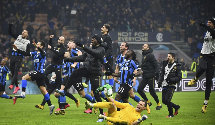 Inter Milan players celebrate after their Serie A soccer match victory over AC Milan at the San Siro Stadium, in Milan, Italy, Sunday, Feb. 9, 2020. (Massimo Paolone/Lapresse via AP)