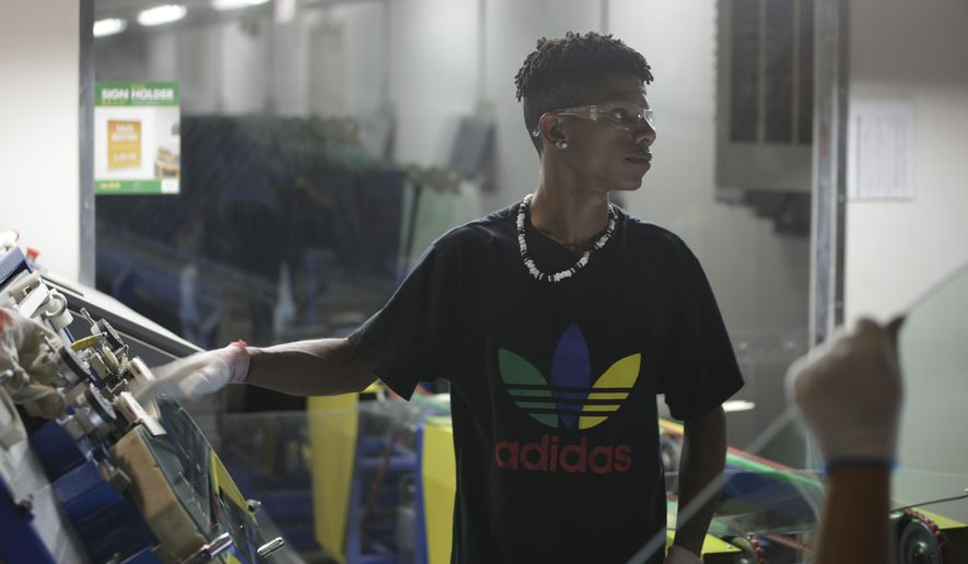 """This image released by Netflix shows Zach Ray at work at the Fuyao Glass America factory in Dayton, Ohio, in a scene from the Oscar-nominated documentary """"American Factory."""" (Netflix via AP)"""
