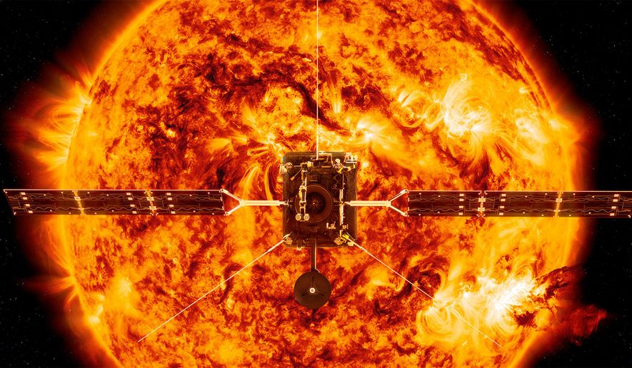 This illustration made available by NASA depicts the Solar Orbiter satellite in front of the Sun. On Sunday, Feb. 9, 2020, NASA and the European Space Agency have planned to launch the spacecraft on a mission to the sun to get close-up views of its polar regions. (ESA/ATG medialab, NASA/SDO/P. Testa (CfA) via AP)