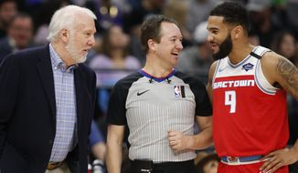 San Antonio Spurs coach Gregg Popovich, left, referee Scott Twardoski , center, and Sacramento Kings guard Cory Joseph have a few laughs during a break in the action during the first quarter of an NBA basketball game in Sacramento, Calif., Saturday, Feb. 8, 2020. (AP Photo/Rich Pedroncelli)