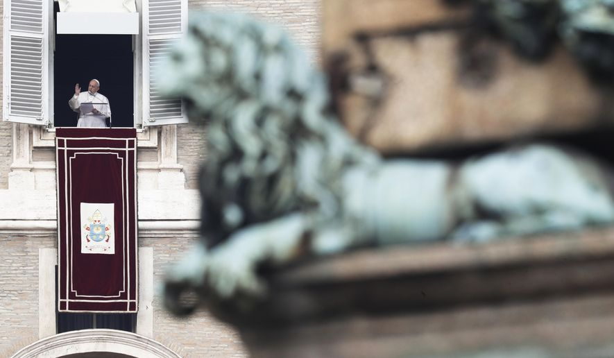 Pope Francis delivers a blessing during the Angelus noon prayer in St. Peter's Square at the Vatican, Sunday, Feb. 9, 2020. (AP Photo/Gregorio Borgia)