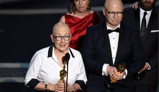 """Julia Reichert, left, and Steven Bognar accept the award for best documentary feature for """"American Factory"""" at the Oscars on Sunday, Feb. 9, 2020, at the Dolby Theatre in Los Angeles. (AP Photo/Chris Pizzello)"""