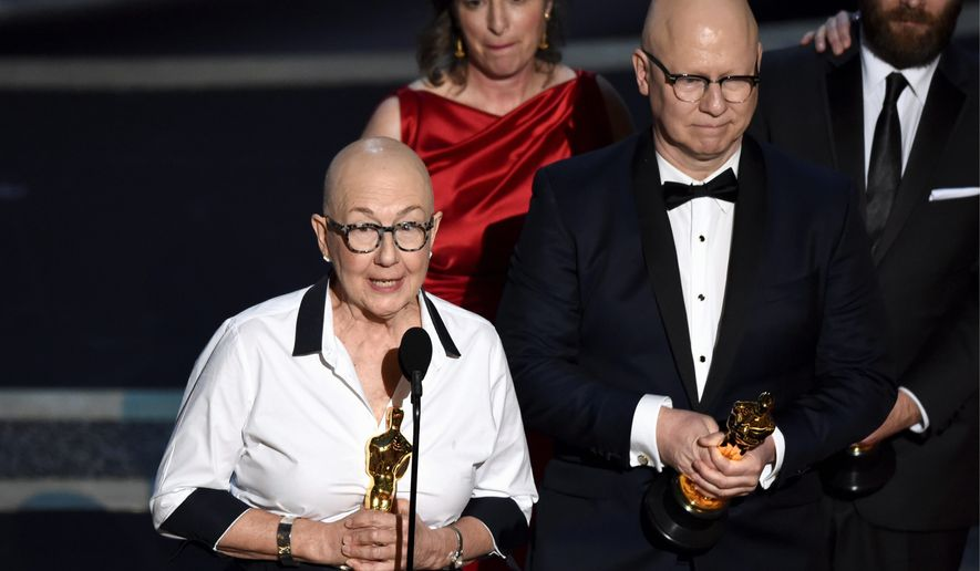 "Julia Reichert, left, and Steven Bognar accept the award for best documentary feature for ""American Factory"" at the Oscars on Sunday, Feb. 9, 2020, at the Dolby Theatre in Los Angeles. (AP Photo/Chris Pizzello)"