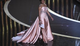 Regina King walks onstage to present the award for best performance by an actor in a supporting role at the Oscars on Sunday, Feb. 9, 2020, at the Dolby Theatre in Los Angeles. (AP Photo/Chris Pizzello)