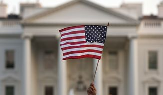 In this September 2017 file photo, a flag is waved outside the White House, in Washington. (AP Photo/Carolyn Kaster) ** FILE **