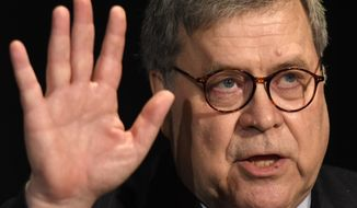 Attorney General William Barr waves after speaking at the National Sheriffs' Association Winter Legislative and Technology Conference in Washington, Monday, Feb. 10, 2020. (AP Photo/Susan Walsh)