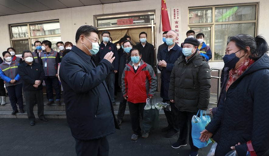 In this photo released by Xinhua News Agency, Chinese President Xi Jinping wearing a protective face mask speaks to residents as he inspects the novel coronavirus pneumonia prevention and control work at a neighbourhoods in Beijing, Monday, Feb. 10, 2020. China reported a rise in new virus cases on Monday, possibly denting optimism that its disease control measures like isolating major cities might be working, while Japan reported dozens of new cases aboard a quarantined cruise ship. (Pang Xinglei/Xinhua via AP)