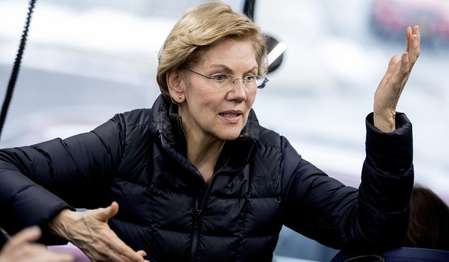 Democratic presidential candidate Sen. Elizabeth Warren, D-Mass., speaks to members of the media on a media bus outside at a campaign stop at Rochester Opera House, Monday, Feb. 10, 2020, in Rochester, N.H. (AP Photo/Andrew Harnik)