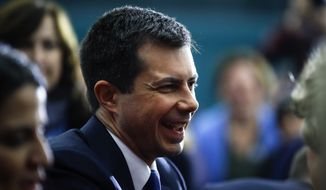 Democratic presidential candidate former South Bend, Ind., Mayor Pete Buttigieg meets with attendees during a campaign event, Monday, Feb. 10, 2020, in Milford, N.H. (AP Photo/Matt Rourke)