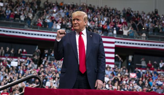 President Trump held a campaign rally Monday at SNHU Arena in Manchester, New Hampshire. (Associated Press)