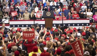 President Donald Trump speaks during a campaign rally, Monday, Feb. 10, 2020, in Manchester, N.H. (AP Photo/Mary Altaffer)