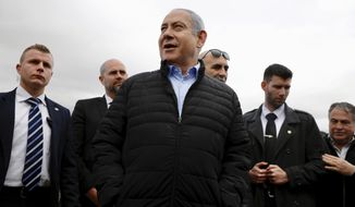 Israeli Prime Minister Benjamin Netanyahu speaks after planting a tree during an event on the Jewish holiday of Tu' BiShvat, in the Jewish settlement of Mevo'ot Yericho, in the West Bank near the Palestinian city of Jericho, Monday, Feb. 10, 2020. (AP Photo/Ariel Schalit)