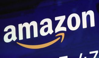 In this July 27, 2018, file photo, the logo for Amazon is displayed on a screen at the Nasdaq MarketSite in New York. (AP Photo/Richard Drew, File)