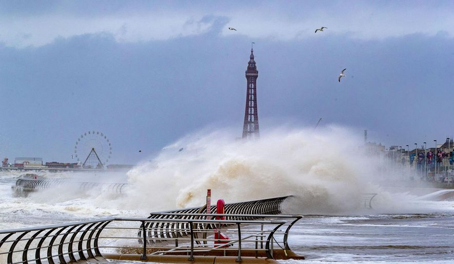 Waves crash over Blackpool waterfront in England, Monday, Feb. 10, 2020. Storm Ciara battered the U.K. and northern Europe with hurricane-force winds and heavy rains Sunday, halting flights and trains and producing heaving seas that closed down ports. Propelled by the fierce winds, a British Airways plane was thought to have made the fastest New York-to-London flight by a conventional airliner. (Peter Byrne/PA via AP)