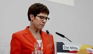 In this Friday, Feb. 7, 2020, photo Annegret Kramp-Karrenbauer, chairwoman of the German Christian Democratic Union (CDU), addresses the media during a press conference at the party's headquarters in Berlin, Germany. Angela Merkel's designated successor will quit her role as head of the Germany's strongest party and won't stand for the chancellorship following a debacle in a regional election. (AP Photo/Michael Sohn)