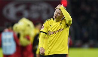Dortmund's Erling Haaland reacts disappointed after losing the German Bundesliga soccer match between Bayer Leverkusen and Borussia Dortmund in Leverkusen, Germany, Saturday, Feb. 8, 2020. Leverkusen defeated Dortmund with 4-3. (AP Photo/Martin Meissner)